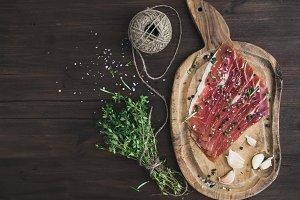 Cured pork meat on a wooden board