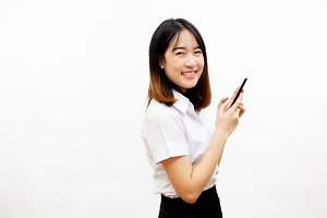 Smiling happy and cheerful Asian female formal dress holding a smart mobile phone  isolated over white background