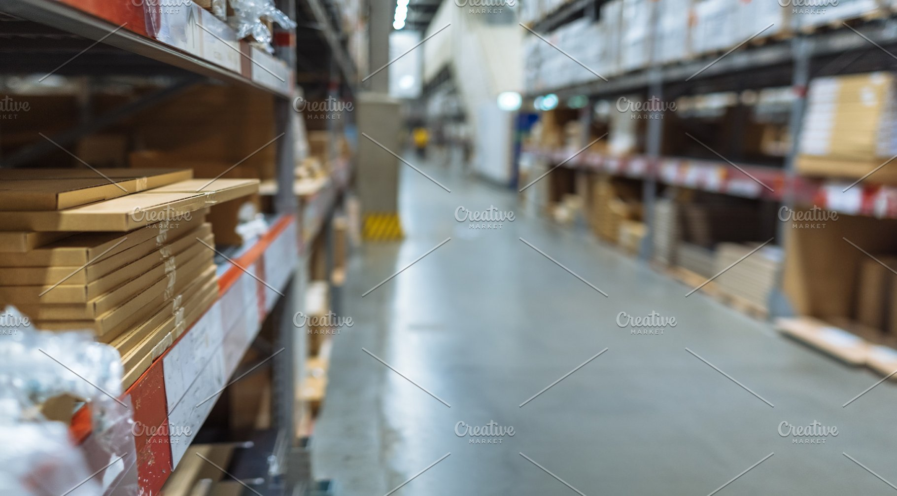 Large warehouse logistic and distribution center  Interior of warehouse  with rows of shelves with big boxes and blurry background, selective focus