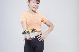 Beautiful smiling woman having a healthy breakfast