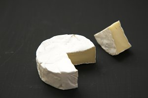 Cheese camembert or brie on dark