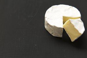 Cheese camembert or brie on dark