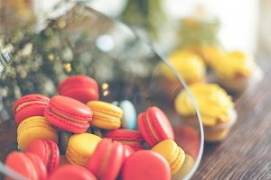 Bright macaroons and cupcakes on a