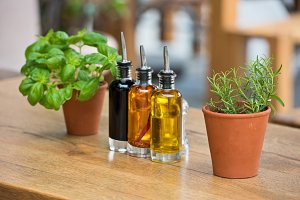 Cafe table with herbs and condiments