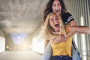 Laughing female friends having a fun night in the city