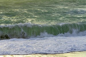 Spray of a sea wave twirling