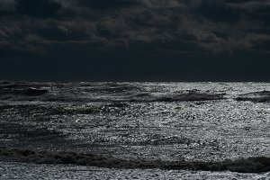 Storm on the sea in the night light
