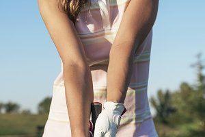 Woman golf player playing golf
