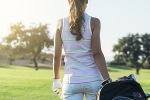 Woman golf player playing golf