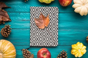 Notebook on green autumn background