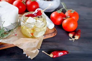 feta in a jar and tomatoes