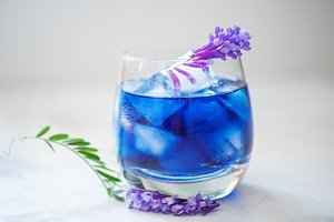 Butterfly pea juice with ice in transparent glass