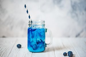 Cold butterfly pea flowers tea with fresh milk
