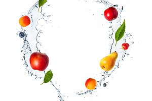 Splash with fruits, berries and fresh mint isolated on white