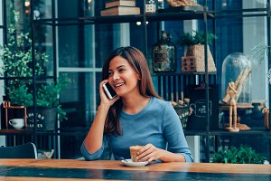 Asian woman in cafe