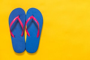 Flip flops on a yellow background