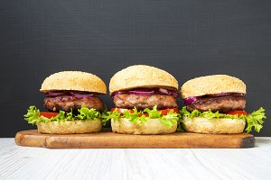 Burgers with beef cutlets on wooden