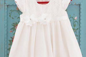 Cute white laced dress on red hanger