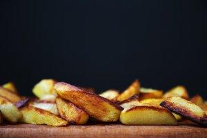 Fast food. Fried potato wedges