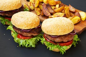 Fresh burgers with fried potatoes