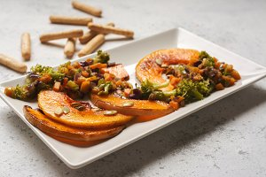 sliced baked pumpkin, with broccoli and assorted vegetables