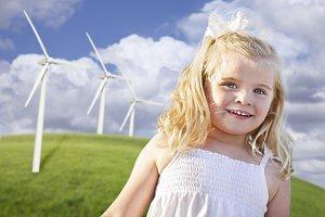 Little Girl Near Wind Turbines