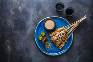 Sate or satay ayam - chicken skewers with peanut sauce, place for wording