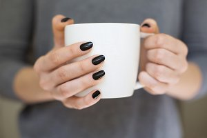 Hands holding coffee cup