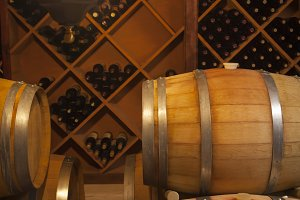 Wine Barrels and Bottles in Cellar