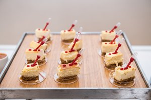 Fancy beautiful mini cakes on wooden