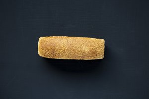 Bread on dark background. From above