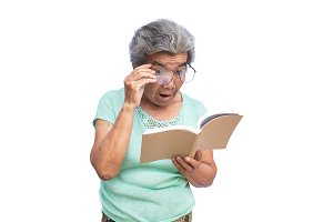 Old woman reading a book on white