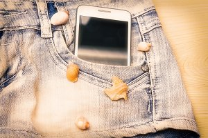 blue short jeans with mobile phone