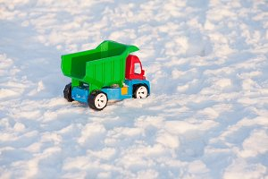 Colour toy truck on the snow