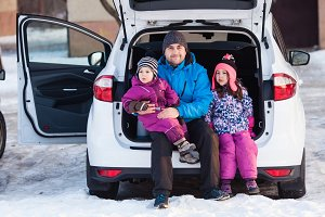 Family travel by car in winter