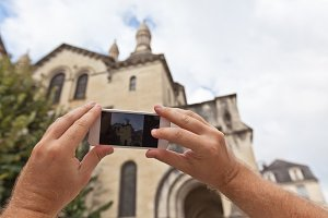 Tourist taking photo of Perigueux,