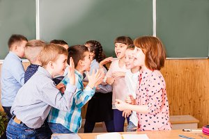 children are communicating with each other during a break