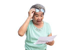 Old woman reading papers on white