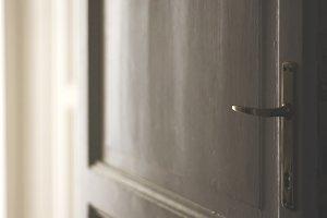 Vintage handle of a white door