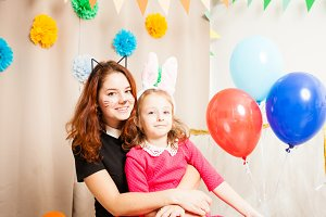Animator with lovely girl playing with balloons
