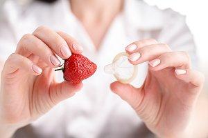 condom in female hands