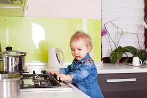 Cute boy wants to prepare something for his mother