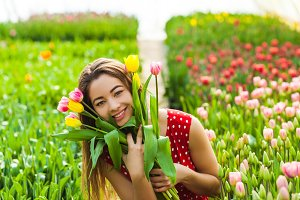 Pretty woman choosing flowers