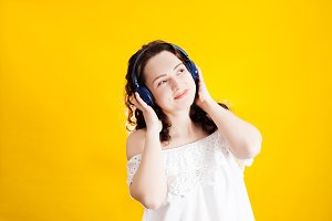 woman listening the music in wireless headphone