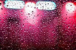 car glass with a clump of rain