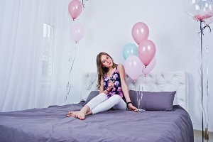 girl with colored balloons
