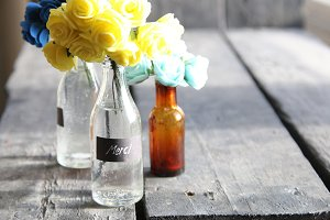 Merci idea, nice flowers in the bottles and tag