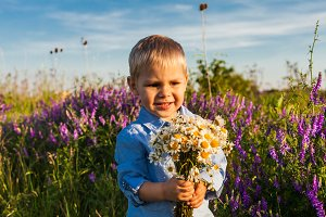 Cute boy with wildflowers