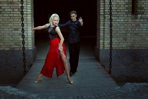 Professional dancers dance tango.