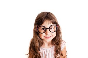 Cute preschool age girl wearing eyeglasses